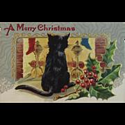Christmas Black Cat at the Fireplace Postcard Embossed Unused