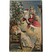 Santa and Sleeping Child Merry Christmas Embossed Postcard Unused Embossed