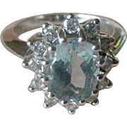 Vintage 14K White Gold Ring Oval Aquamarine Surrounded by 12 Round Diamonds