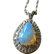 Superb Opal Surrounded by Diamonds Pendent Necklace, 14K White Gold