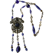Ornate Necklace from Czechoslovakia Art Deco Era Deep Purple Glass Beads Brass Metalwork and Dangles