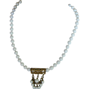 Elegant Miriam Haskell Necklace Mid-Century White Glass Beads with Brass Dangle
