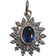 Vintage Pendent Oval Sapphire Surrounded by Diamonds Set in 18K Yellow Gold Classic Design