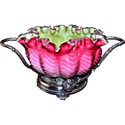 Brides Basket/Centerpiece:  Lovely Pink Satin Mother of Pearl Herringbone Deeply Ruffled Brides Bowl with Green Interior Sitting Atop Meriden SP #01502 Brides Basket Featuring Branch Handles and Orange Decor
