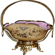 Brides Basket: Stunning Honey Yellow Cased Art Glass Brides Bowl Pink Interior with Enamel, Gold and Silver Bee, Butterfly and Floral Decor Sitting in Spectacular Footed Dare Gold Handled Basket Featuring Ornate Detailing and Cut Out Flowers