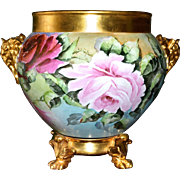 Limoges Stunning Rose Jardiniere with Gold Elephant Handles Sitting Atop Gold Pawed Footed Plinth