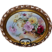 Limoges Oval Hand Painted and Signed Porcelain Plaque with Yellow, Red and Pink Roses in Ornate Gold Rococo Frame