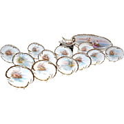 Limoges Rare and Unique 15-Piece Signed Fish Set Decorated with Playful Putti/Cherubs