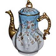 Limoges Beautiful Blue Hued Tea Pot with Unusual Swirl Molding and Ornate Leaf Handle Covered in White and Gold Cherry Blossom and Branch Decor