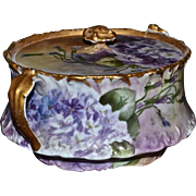 Limoges Biscuit Jar with Dramatic Hues and Covered in Purple and White Violets