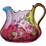 Limoges Ornate Cider Pitcher with Bulbous Shape and Covered in Red and Pink Roses
