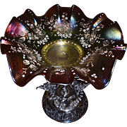 Brides Basket/Centerpiece: Victorian Rindskoph Iridescent Fluted Art Glass Brides Bowl Raised Gold and Enamel Foliate Decor Sitting Atop Rogers, Smith & Co. Basket with Elaborately Scrolled Base, Winged Floral Arches and A Centralized Cherub