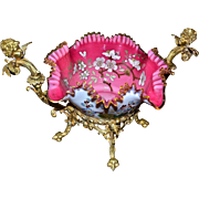 Brides Basket/Centerpiece: Exquisite Victorian Cased Art Glass Ruffled Bowl White Exterior Decorated with Florals and Breathtaking Pink Interior Heavily Adorned with Enamel/Gilt Cherry Blossoms Sitting in Dore Bronze Base with Figural Cherub Handles