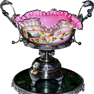 Brides Basket/Centerpiece:  Amazing Webb Cased Rainbow Swirl Brides Bowl with Gold/Enamel Floral and Landscape Decor with Pink Interior and Clear Ribbon Ruffled Edge Sitting On Pelton Bros Quadruple Plate Basket Featuring Cherry and Leaf Decor