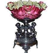 Brides Basket/Centerpiece: Pink Thomas Webb Mother of Pearl Folded/Ruffled Pink Diamond Quilt Brides Bowl Phenomenal Gold Floral, Beading and Flourish Decor with Green Interior Sitting On Fabulous Meriden Quadruple SP #1684 Basket with Winged Cupids