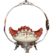 Brides Baset: Lovely Folded and Ruffled Cream and Red Cased Art Glass Brides Bowl with Enamel Floral Highlights and Setting In Rogers #1669 Silver Plate Frame with Cherub Cut Out Medallions