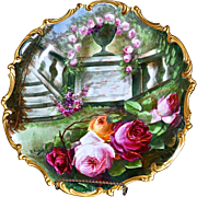 Limoges Huge Plaque/Charger of Garden Scene Showcasing Pink, Yellow and Red Roses with Pink Roses Cascading From Urn Sitting on Wall Signed Master Artist J. Soustre