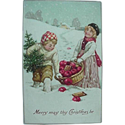 Merry May Thy Christmas Be Incised Christmas Postcard Kids Carrying Basket Of Apples And  Tree