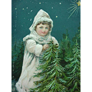 Christmas Greetings Incised Postcard Girl Dressed In White Standing By Two Evergreen Trees Printed In Germany