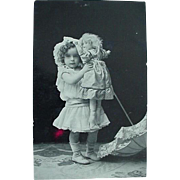 Rppc Real Photo Postcard Girl With Doll And Parasol On Floor