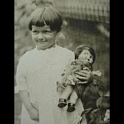 Photograph Photo Girl Holding Her Google Eye Doll