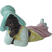 Black Americana Majolica Figurine Girl Lying Down With Hand To Her Chin