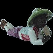 Black Americana Majolica Figurine Boy Lying Down Eating Watermelon