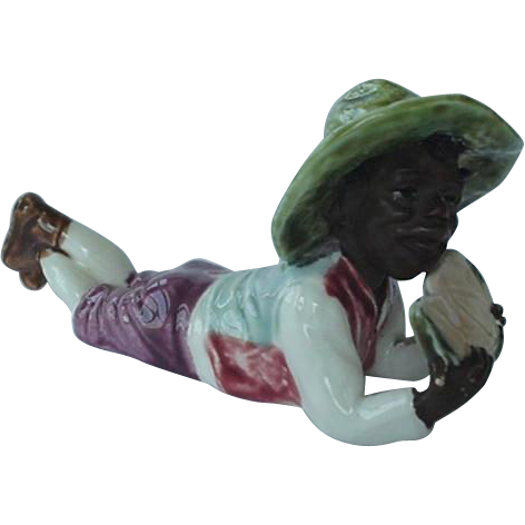 Black Americana Majolica Figurine Boy Lying Down Eating