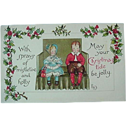 Ernest Nister Christmas Postcard With Two Children Seated On Bench