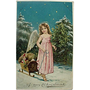 A Merry Christmas Incised Postcard Child Angel Pulling Small Sled Of Toys Made In Germany