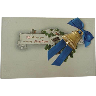 New Year Postcard With Belll And Blue Ribbon In Relief