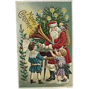 Embossed Postcard Santa With Phonograph Children Tree And Basket Of Toys Postcard Made In Germany