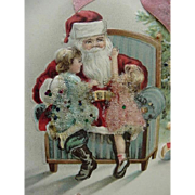 Embossed Santa With Girls Sitting On Lap Postcard Glitter On Dresses And Pink Ribbon Top Of Card