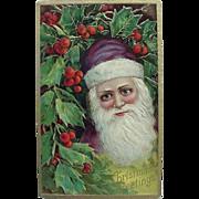 Christmas Embossed Postcard Santa Saint Nicholas In Purple Cap Holly And Berries Printed In Germany