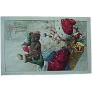 John Winsch 1913 Santa Christmas Postcard Holding Teddy Bear Pipe In Mouth Basket Of Toys Doll Drum Horse