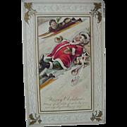 Santa Sliding Down Hill Christmas Postcard