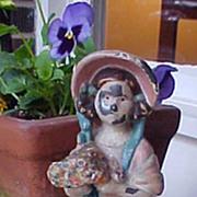 Cast Iron Doorstop Girl In Bonnet Holding Flowers