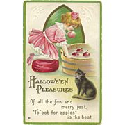 Vintage Halloween Postcard Girl in Pink bobs for apples with black cat