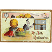 Early 1910 Vintage Halloween Postcard with Pumpkinheads bobbing for apples 2097