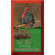 HO! For a Holly Thanksgiving vintage Postcard Turkey resting on Axe. Gold Gilt Gel Series 7152