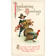 1915 Vintage Thanksgiving Postcard with boy carrying a basket of corn and Turkey tagging along T-63