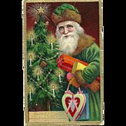 1909 PFB Beautiful Santa Claus Green Robe Brown Fur Holding Presents Postcard