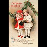 Signed Ellen Clapsaddle Children caroling at Christmas vintage postcard