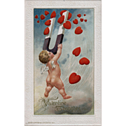Rare John Winsch 1913 Valentine featuring Cupid using a magnet to pull down hearts from heaven