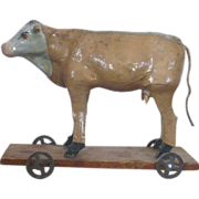 5.25 Inch Composition & Wood  Brown Painted Brindle Cow on Platform with Wheels