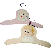 2 Pastel Painted Wood Child's Clothes Hanger with Sweet Baby Portraits