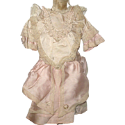 Lace Trimmed Pink and Ivory Satin Dress with Overskirt Ruched and Ruffled Bodice