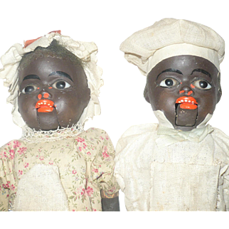 12.5 Inch Black Composition Cook and Maid with Glass Eyes Mouths Open Squeakers