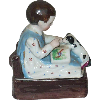 Fine Mid 19th Century China Trinket Box Pink Tint Toddler with Brown Hair Picture Book and Puppy on Lid