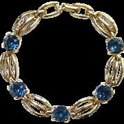Vintage Kramer Sapphire Blue Rhinestone Goldtone Link Bracelet Signed